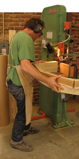 Ray cutting wood with his bandsaw.